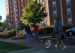 SFA students carrying trombones and unicycles...that is all.