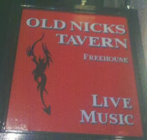 freshly painted red pubsign with black wriggly devil for Old Nicks Tavern