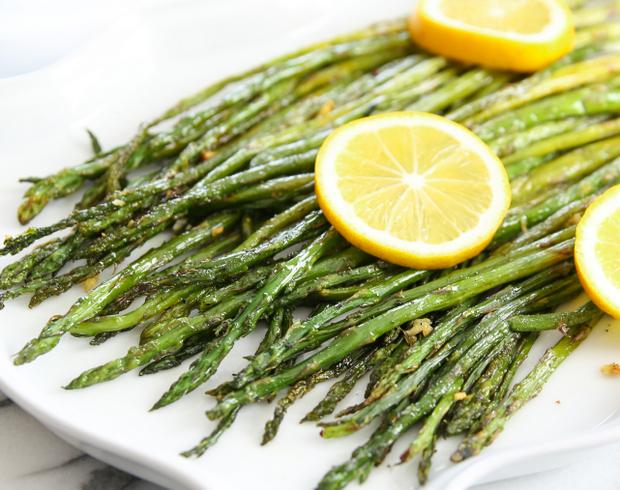 photo of Lemon Garlic Roasted Asparagus on a serving platter
