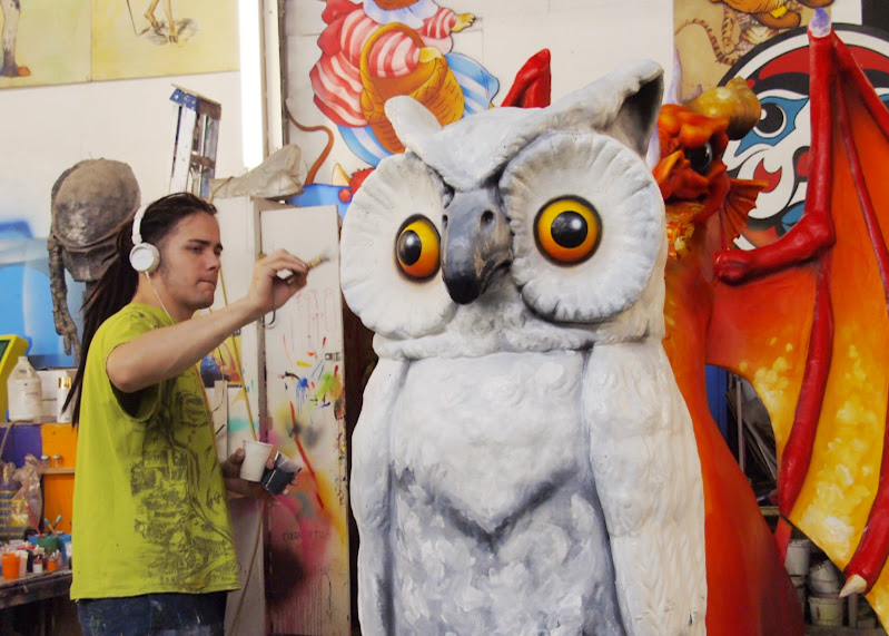 Putting the finishing touches on an owl in Mardi Gras World