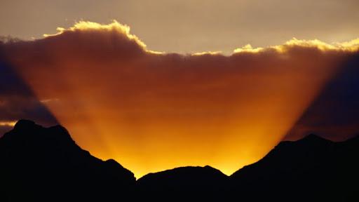 Sun Silhouetting Sierra de la Giganta Mountains, Loreto, Baja California.jpg