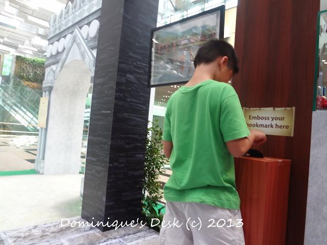 Monkey boy embossing his bookmark