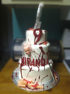 Three tier Dexter blood splatter custom unique creative birthday cake idea with edible knife, scapel and cut up barbie doll