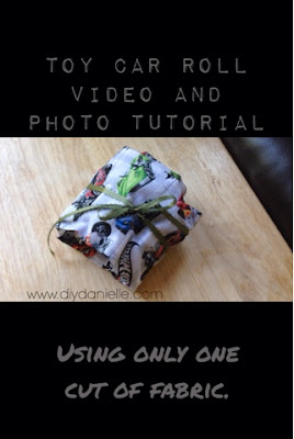 How to make a toy car roll using only one cut of fabric and some coordinating ribbon. Easy project for sewing beginners!