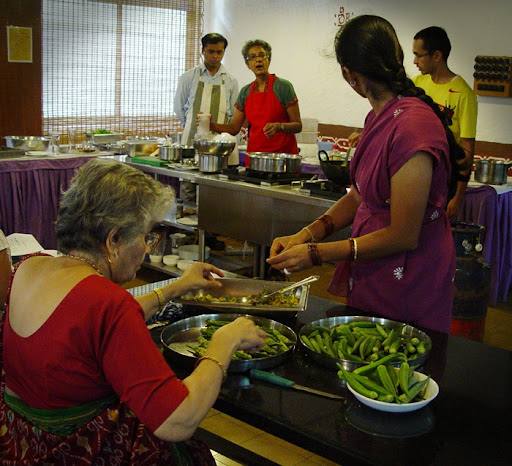Volunteers stuffing Bhindis