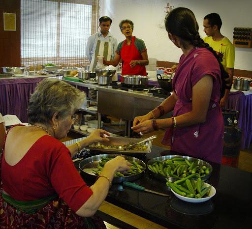 Volunteers stuffing Bhindis