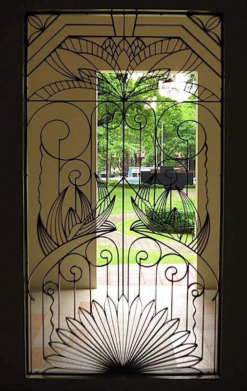 one of the wrought iron windows of the St. Stanislaus Kostka Chapel of the Ateneo de Manila High School