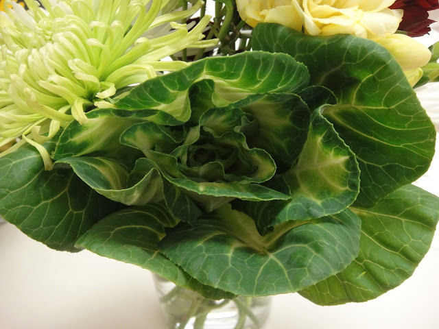 The kale used in this arrangement adds a nice touch of green.