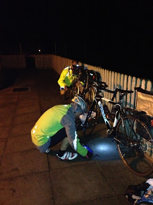 Cyclist fixing puncture at night