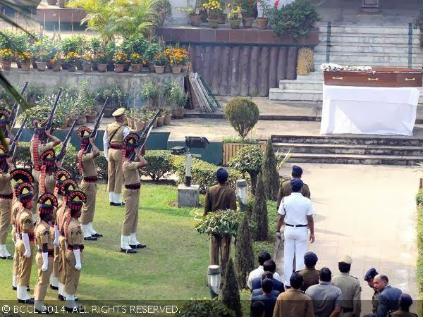 Policemen give gun salute to the late actress Suchitra Sen during her funeral, in Kolkata.