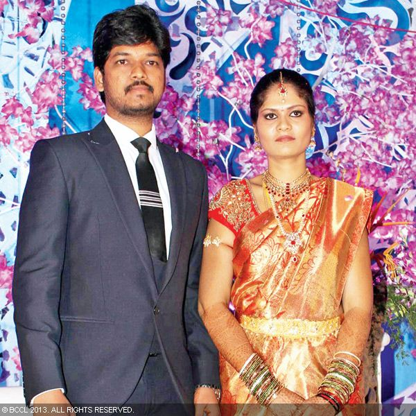 Naveen and Varsha pose for the shutterbugs during their wedding reception party, held recently in Hyderabad.