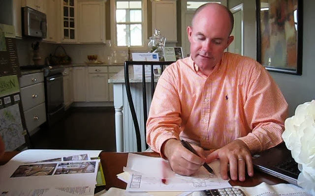Peter Winkler with Homes by Dickerson working on a custom home plan.