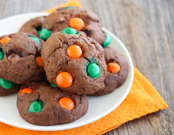 close-up photo of Chocolate Pumpkin Spice M&M Cookies piled on a plate