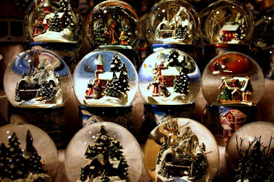 Snow globes for sale at a Christmas market in Salzburg Austria