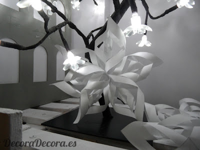 Hacer estrellas de papel para decorar en Navidad.
