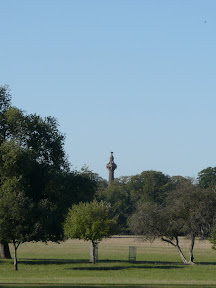 Cokes Monument appears above the trees
