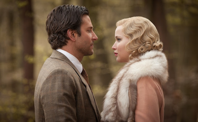Bradley Cooper as George Pemberton and Jennifer Lawrence as Serena