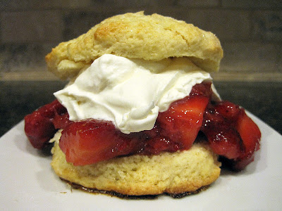 Strawberries and whipped cream on a shortcake biscuit.