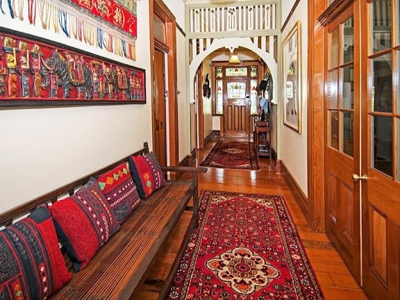 This hallway has a Federation style fretwork arch in timber, timber floors and timber woodwork throughout.