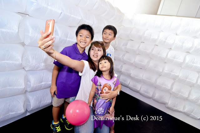 Attempting to take a wefie with the kids at the breathing wall