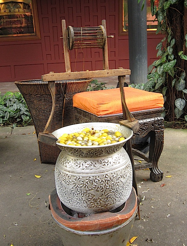 cocoons being boiled at the Jim Thompson House in Bangkok, Thailand