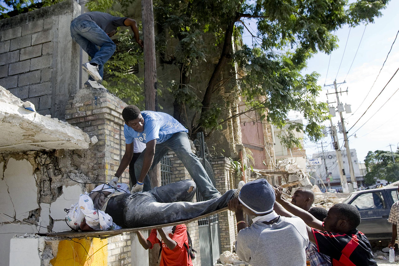 Haitians pull out a body from the rubble of a school that collapsed after the earthquake that rocked Port au Prince on January 12. Ethical machine learning engages local communities. Photo Marco Dormino.