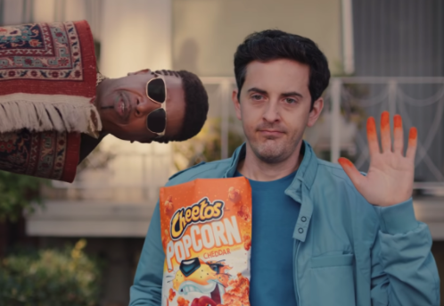 Cheetos Superbowl ad: MC Hammer with a Cheetos box in hands