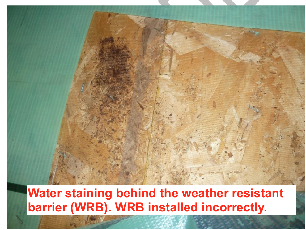 water staining on wall sheathing from construction defect