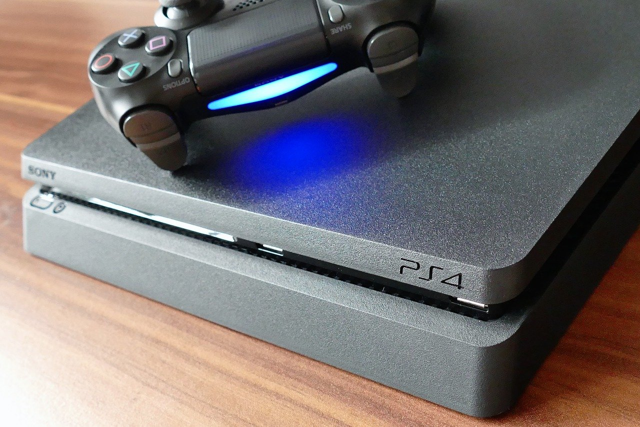PS4 Controller Flashing White Sony PlayStation 4 with a DualShock 4 Controller