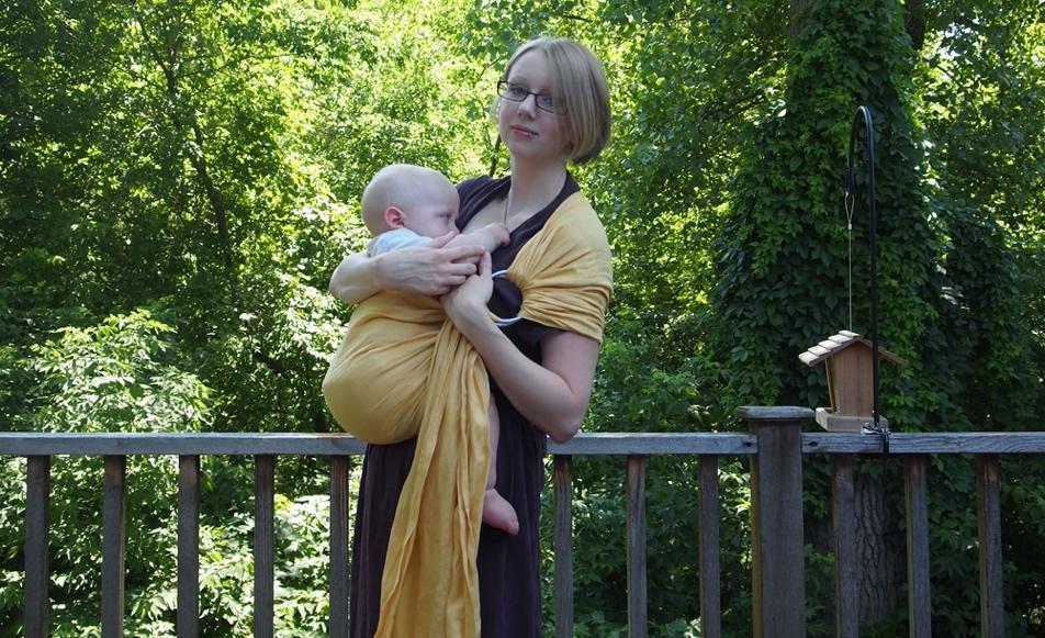 Baby breastfeeding in a ring sling