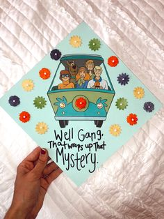 """A graduation cap that reads """"Well gang, that wraps up that mystery"""""""