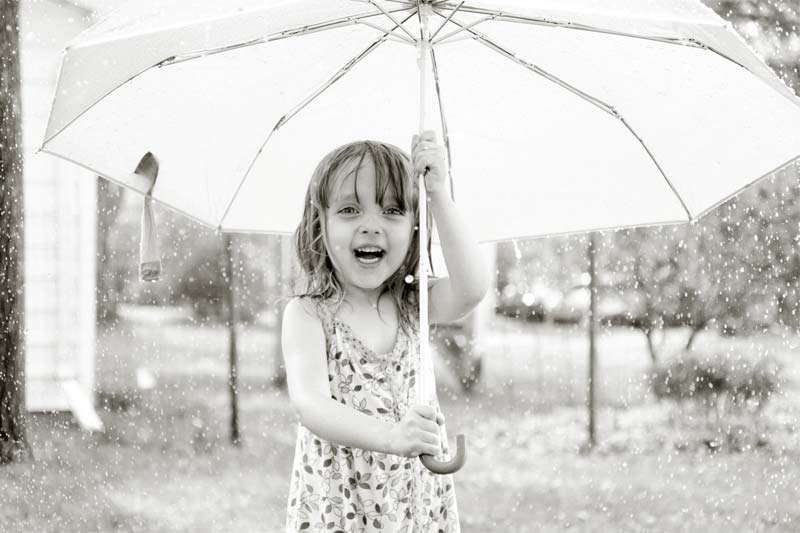 A child playing in the rain.