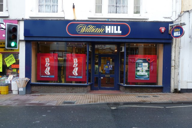A William Hill bookies with sale signs visible