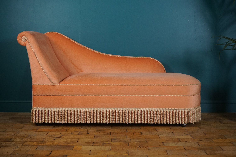 mid-century peach chaise longues