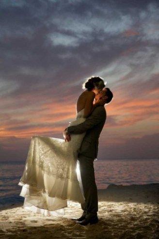 brides having a romantic moment in a dim white light