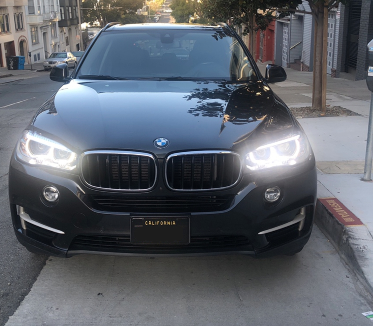 My BMW X5 near the red curb