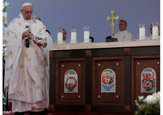 Pope Francis spreads incense on the altar as he celebrates a Mass in Tbilisi's stadium, Georgia, Saturday, Oct. 1, 2016. - AP