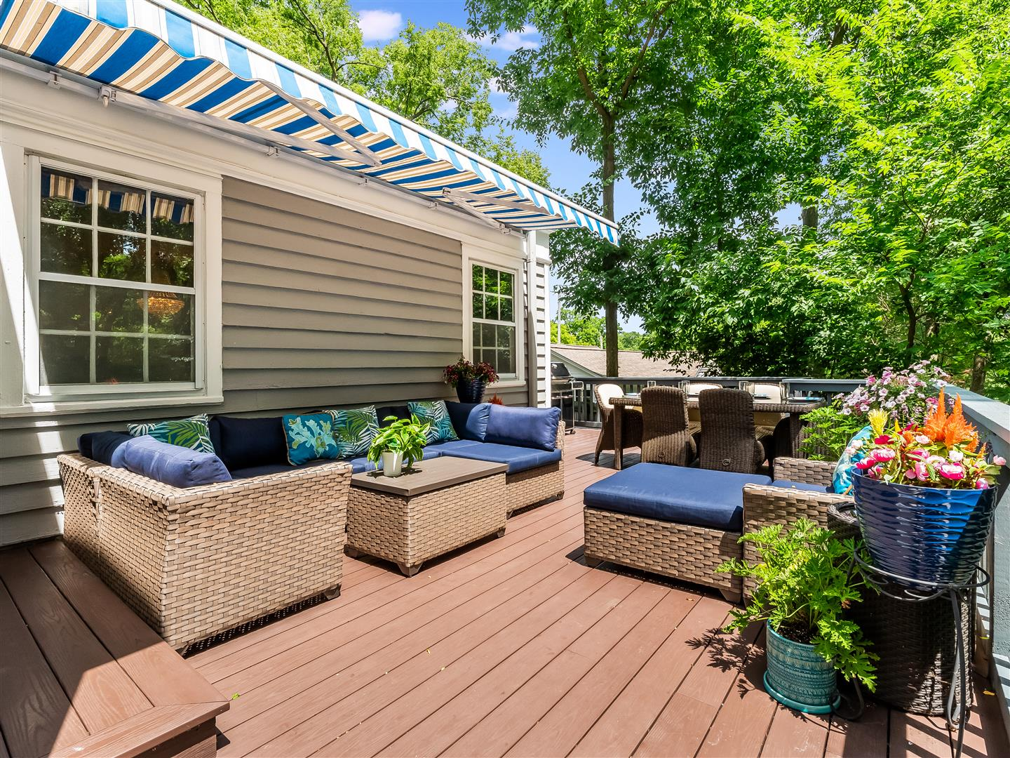 Outdoor deck with retractable awning with dining and  living space