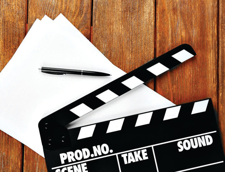 Picture of a clapperboard with script