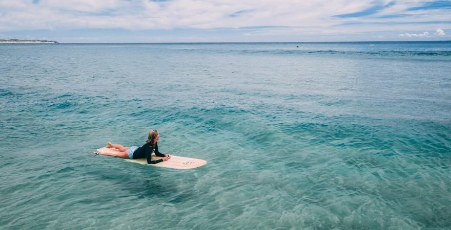 woman on surfboard