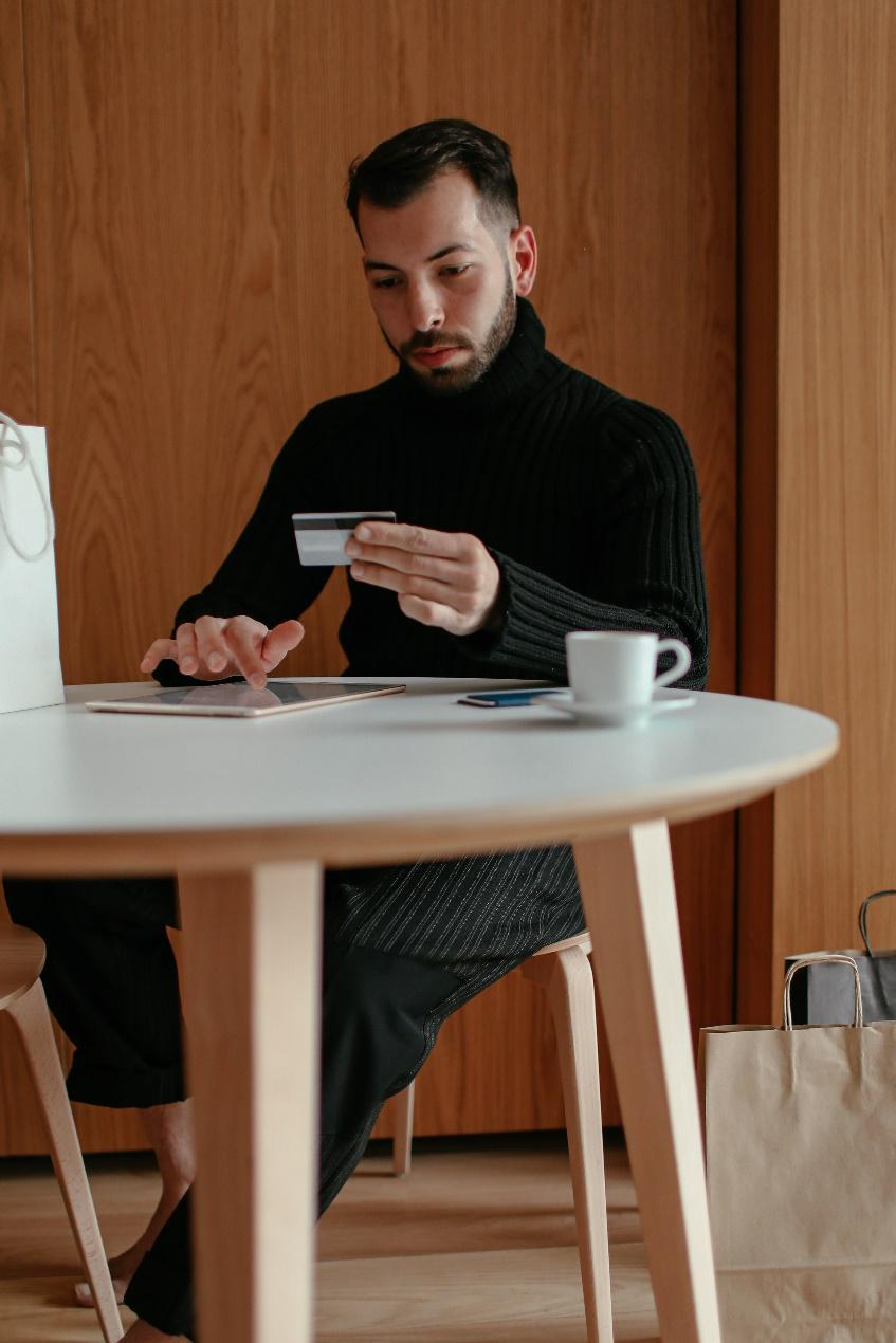 A person sitting at a table  Description automatically generated with medium confidence