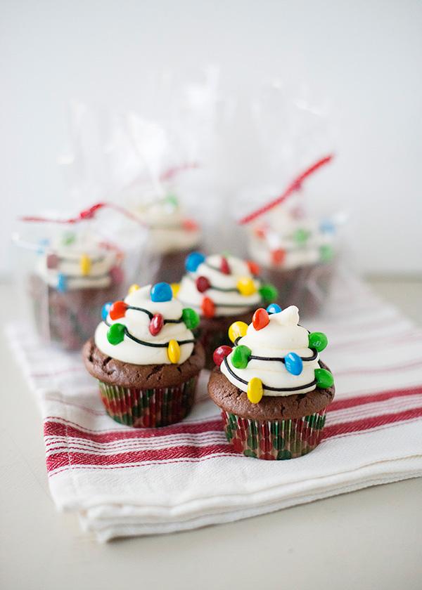 Light up cupcakes A Baker's Dozen Christmas Cupcake Recipe Ideas via Kara's Party Ideas