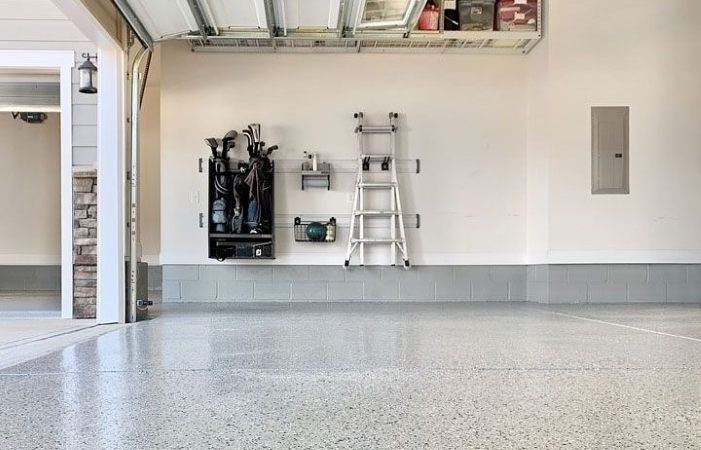a residential garage with epoxy flooring