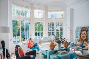 A bright living room full of lively colored furniture