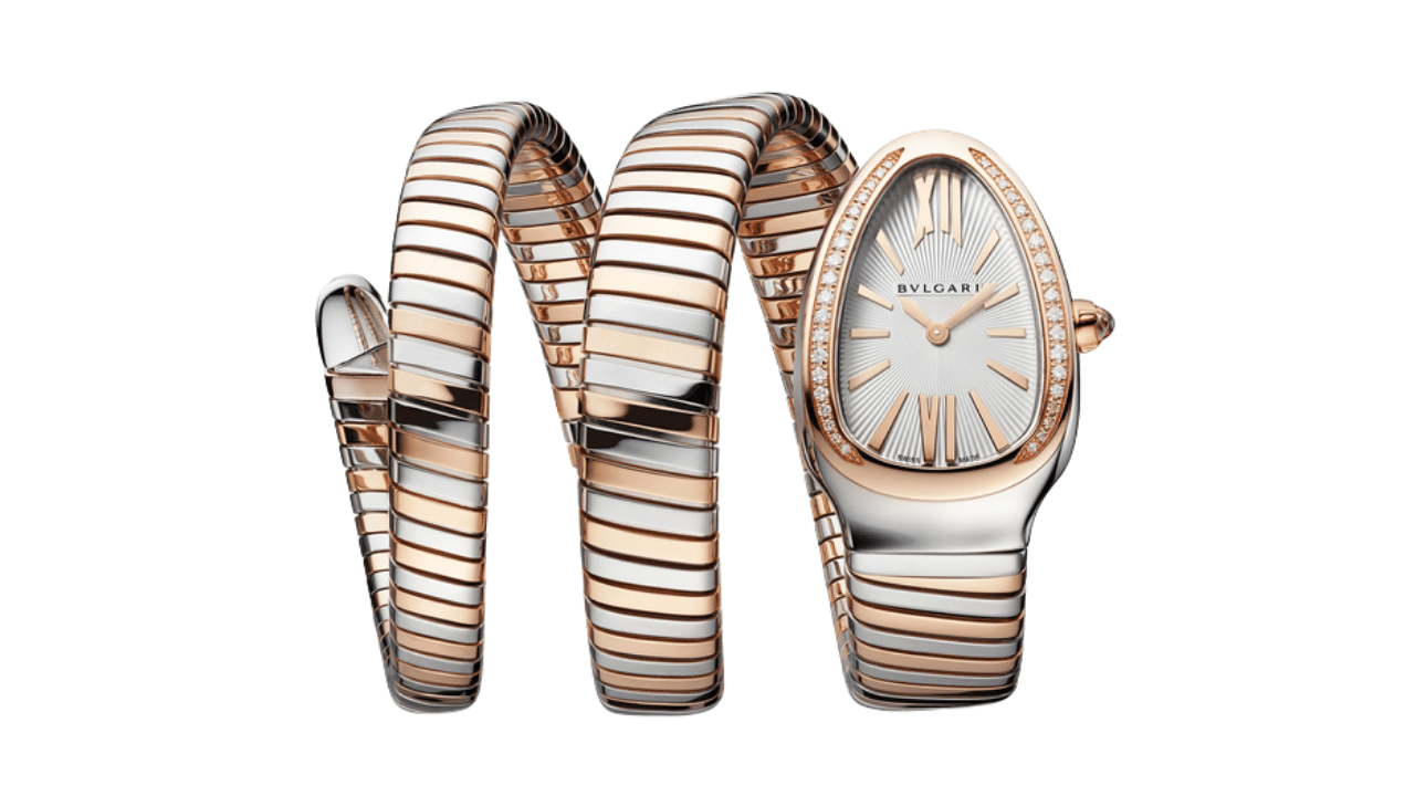 A Bulgari Serpenti Tubogas watch in two tones; gold and steel. With a diamond bezel.
