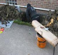 Men digging to find crack