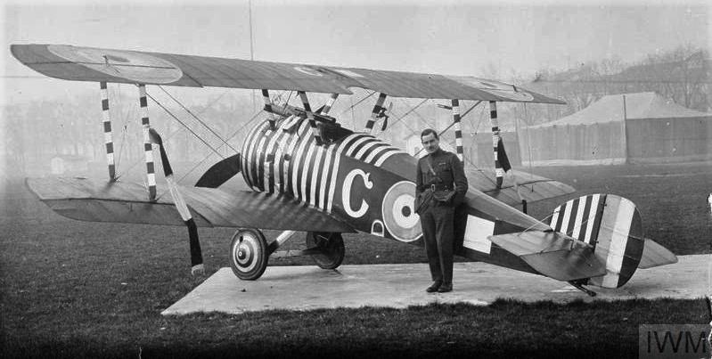Captain Wilson of No. 28 Squadron RAF by his Sopwith Camel biplane, Florence..jpg
