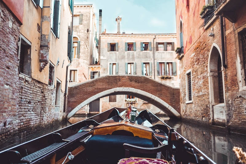 view from seat of gondola on venice canal