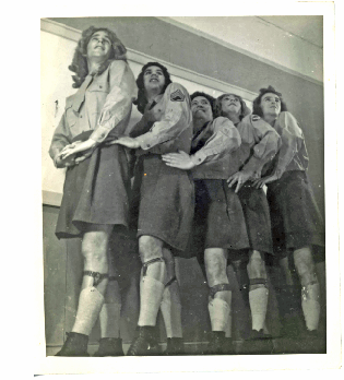 Five crossdressed solders standing in a line at a performance