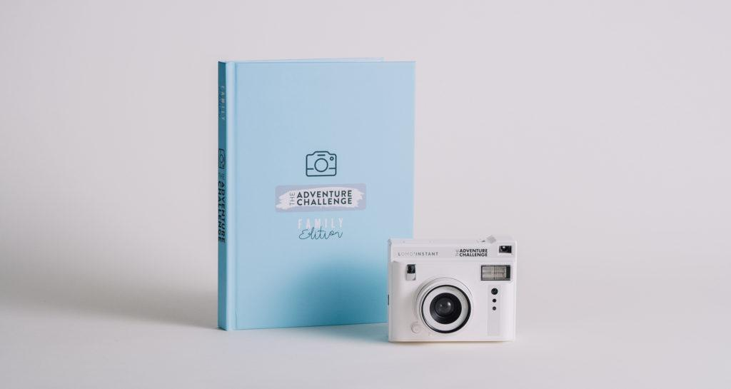 a blue book with camera in front of it